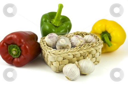 Bell peppers and basket with garlics stock photo, Three bell peppers and basket full of fresh garlics isolated on white background by Gert-Jan Kappert