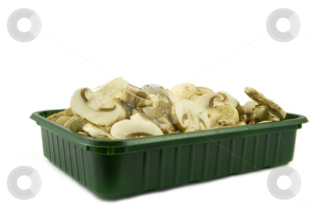 Sliced champignon mushrooms in green pack stock photo, Sliced champignon mushrooms in green pack isolated on white background by Gert-Jan Kappert