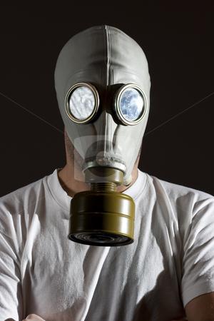 Gas mask danger  stock photo, A man wearing a gas mask environment danger concept image by Ivan Montero