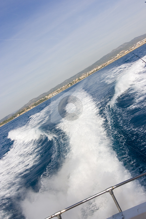 Yacht tail path stock photo, A boat sailing in the sea behind the yacht by Ivan Montero