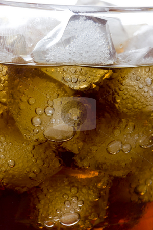 Cold coke drink stock photo, Cola soft drink in a glass full of ice cubes by Ivan Montero
