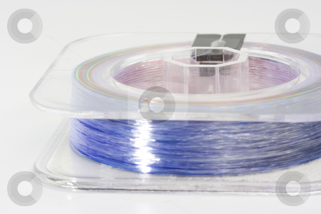 Sport fishing line stock photo, Nylon line used for sport fishing in saltwater by Ivan Montero
