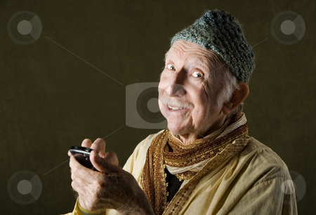 Cell Phone Guru stock photo, Wise Man with Knit Cap Talking on Cell Phone by Scott Griessel