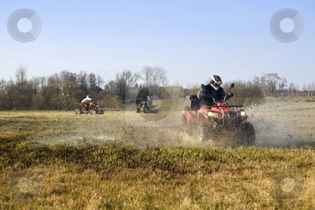 Group of quads stock photo, Autumn afternoon and three quads in field by Tom P.