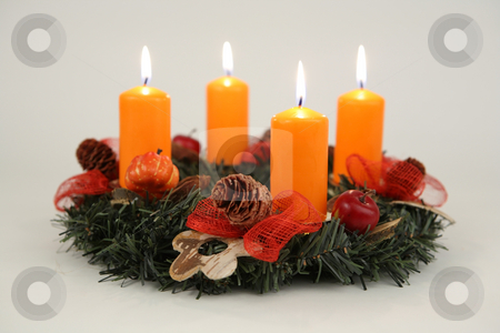 Orange candles stock photo, Advent wreath with four candles by Tom P.