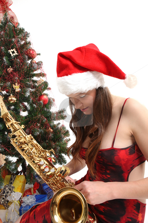 Woman and christmas tree stock photo, Nice girl is holding her christmas present by Tom P.