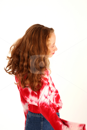 Curly little girl stock photo, Back view of schoolgirl while she's dancing by Tom P.