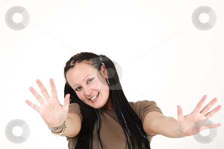 Young woman waving stock photo, Young woman prepares to say goodbye by Tom P.