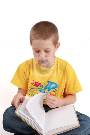 Sitting boy stock photo, Young boy is reading the book - on white background by Tom P.