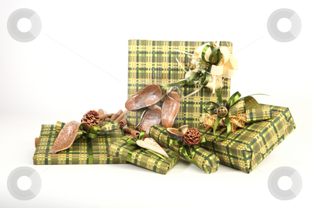 Christmas presents stock photo, Five christmas presents in green paper with unusual decorations by Tom P.