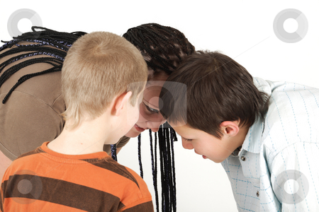 Three teenagers stock photo, Three teenagers has a time to play by Tom P.