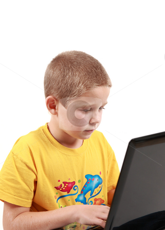 Young boy with laptop stock photo, Young boy is working with his laptop - on white background by Tom P.