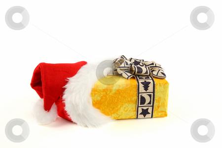 Christmas present stock photo, Christmas present in santa's cap by Tom P.