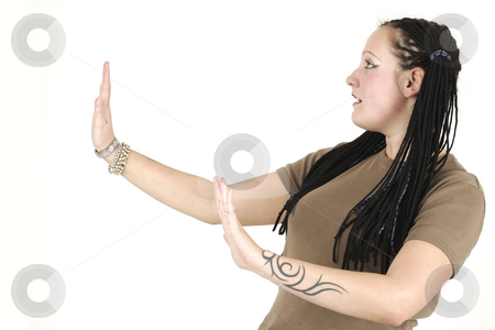 Concentrated woman stock photo, Concentrated woman shows tai chi by Tom P.