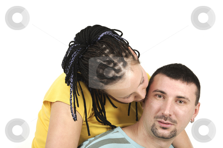 Lovers stock photo, Young girl is kissing her boyfriend by Tom P.