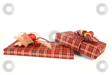 Christmas presents stock photo, Two christmas presents in red paper with unusual decorations by Tom P.