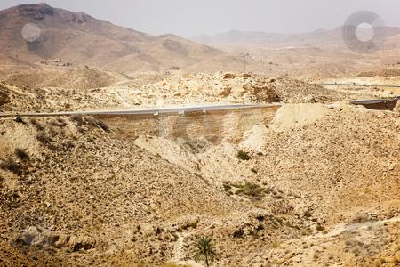 Sahara desert stock photo, Hot summer sahara desert with one road only by Tom P.