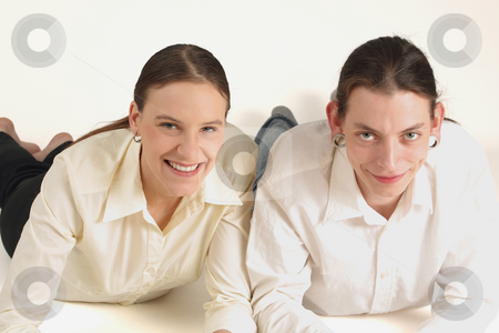 Two young colleagues stock photo, Two young colleagues lying and smiling ahead by Tom P.