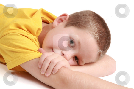 Young boy is lying stock photo, Young boy is lying on the white background. by Tom P.