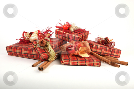 Christmas presents stock photo, Five christmas presents in red paper with unusual decorations by Tom P.