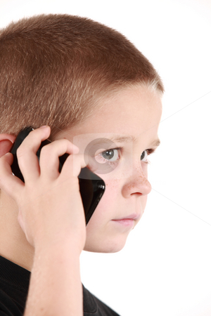Young boy stock photo, Young boy is holding the phone and wait for call by Tom P.