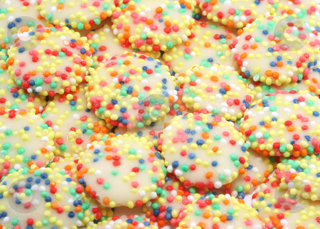 Rainbow White Chocolate Drops stock photo, All time childrens favourite confectionary - white chocolate drops with multicoloured sprinkles by Helen Shorey