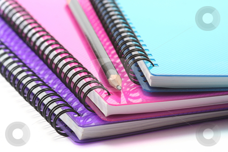 Notebooks and Pencil stock photo, A selection of brightly coloured spiral bound notebooks with pencil by Helen Shorey