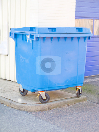 Clean blue plastic rubbish bin in urban area stock photo, Clean blue plastic rubbish bin in urban area with copyspace by Phillip Dyhr Hobbs