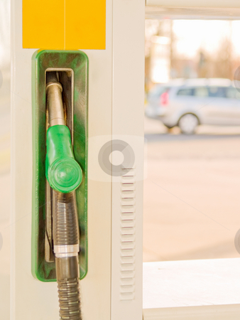 Service Station - Fuel nozzle with car in background stock photo, Service Station - Fuel nozzle with car in background by Phillip Dyhr Hobbs