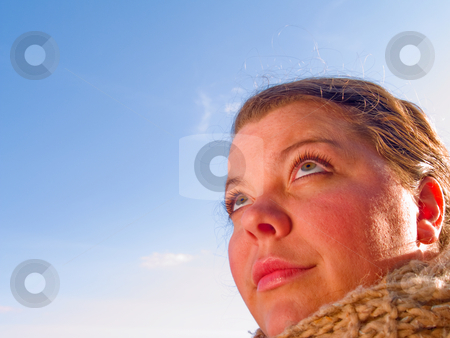 Woman looking up at copyspace stock photo, Beauty - Close up Portrait of a woman looking up at copyspace by Phillip Dyhr Hobbs