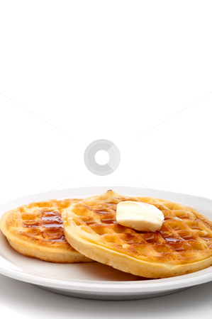 A vertical image of two frozen breakfast waffles with a pat of b stock photo, A vertical image of two frozen breakfast waffles with a pat of butter and maple syrup on a white plate with space for copy by Vince Clements