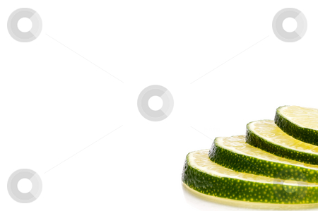 A horizontal close-up of juicy fresh cut lime slices with space  stock photo,  by Vince Clements