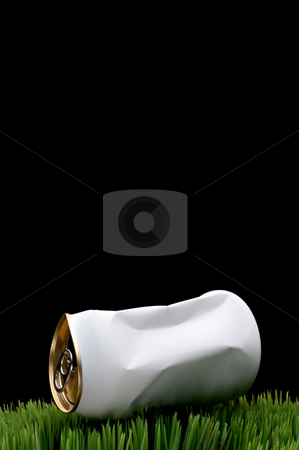 A vertical image of a white crushed soda can tossed on green gra stock photo, A vertical image of a white crushed soda can tossed on green grass instead of being recycled by Vince Clements