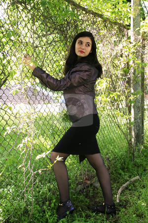 Obstacle stock photo, The beautiful girl has caught fingers in a fence by Aleksandr GAvrilov