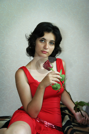 Red rose stock photo, The beautiful girl holds a scarlet rose by Aleksandr GAvrilov