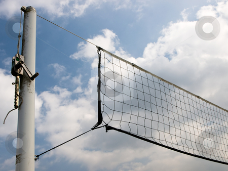 Beach volley ball stock photo, Close-up of a beach volleyball net with a cloudy sky in background. by FEL Yannick