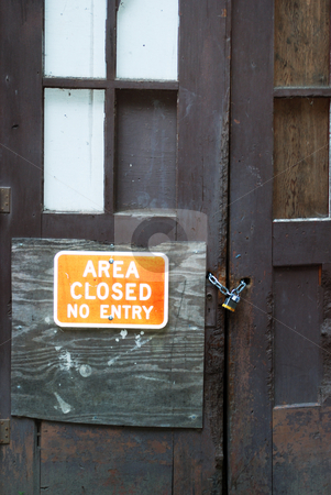 Area Closed No Entry stock photo, Area Closed No Entry sign on a door locked with a lock and chain. by Denis Radovanovic