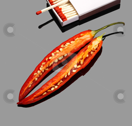 Red chili peppers stock photo, Fresh red chili peppers  with matches over grey reflective surface by Francesco Perre