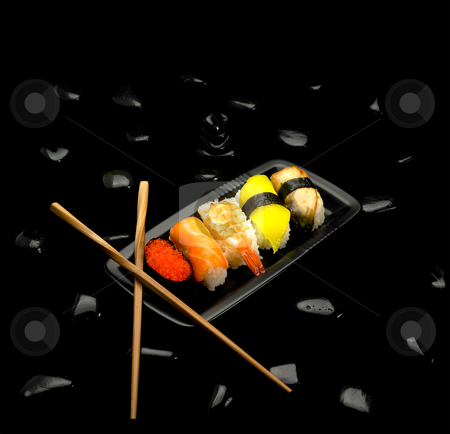 Sushi plate stock photo, Fresh colorfull sushi plate over black pebbles by Francesco Perre