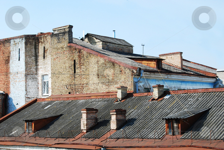 Roofs stock photo, Tile roofs of old brick houses by Leyla Akhundova