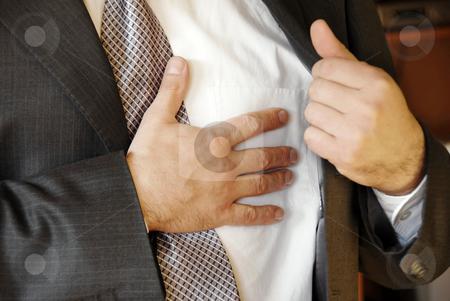 Stressful job troubles stock photo, Businessman  hand on chest, stressful job troubles by Julija Sapic