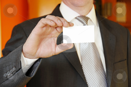 Businessman showing business card stock photo, Businessman hand holding and showing blank business card by Julija Sapic