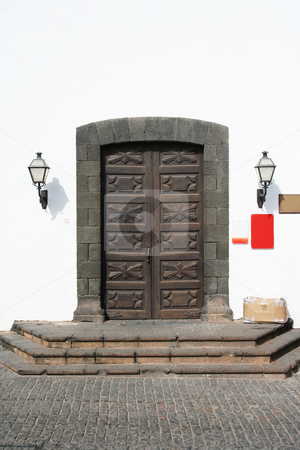 Old Museum Doors stock photo, Beautifully carved wooden doors to a monastry, now a museum. Shaped lava rock surround and an old cardboard box of stuff on the doorstep! by Helen Shorey
