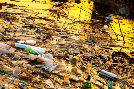 Trash in lake stock photo, Trash in lake by Alexey Rumyantsev