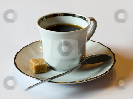 Coffee time stock photo, A ceramic coffee cup with a brown sugar cube and spoon isolated on a white background. by FEL Yannick