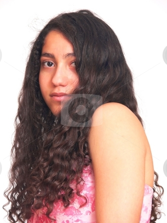 Portrait of young girl    stock photo, An portrait of a young teenager from the side and her long curly hair hangs down, in a pink dress. On white background. by Horst Petzold