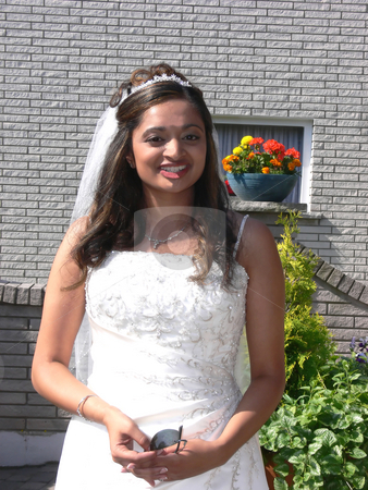 Outside portrait of the bride   stock photo, An outside portrait of the young bride before the ride in the limo to church. by Horst Petzold