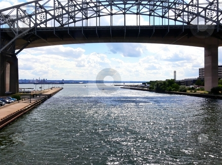 Lift bridge  stock photo, An lifted up lift bridge over the canal to the harbor of Hamilton with sparkling water waves. by Horst Petzold