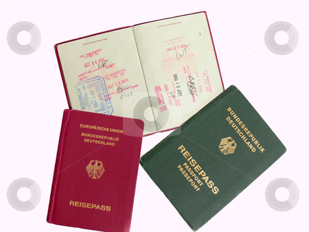 German passports   stock photo, Three German passports, two in red and one old passport in green. There are different stamp of entry in different countries. by Horst Petzold