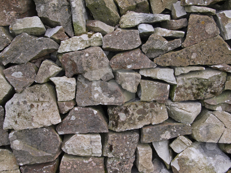 Dry stone wall stock photo, Close-up of a dry stone, farm wall. by Ian Langley